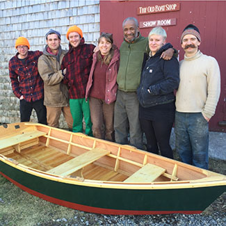apprentices posing with finished skiff