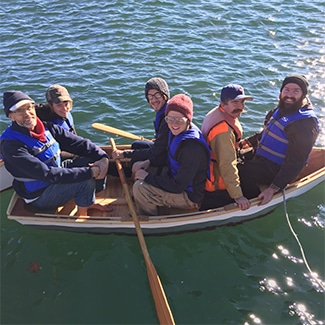 apprentices try out a new skiff